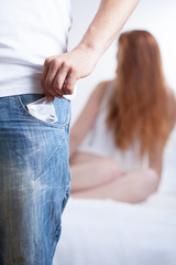 Man having condom in pocket