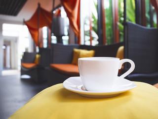 coffee on pillow sofa interior background