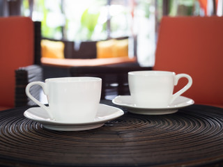 Two cup of coffees interior background
