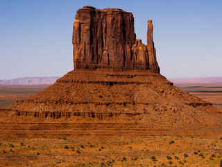 Towering sandstone butte in Monument Valley
