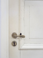 Door handle on wooden door vintage style