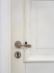 Door handle on wooden door vintage style