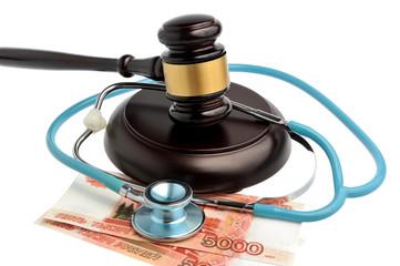 Stethoscope with judge gavel, money isolated on white
