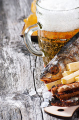 Beer cup with snack on wooden background