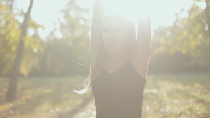Close up of a girl doing stretching in the fresh air
