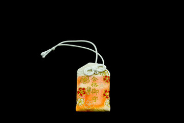 Japanese charms commonly sold at religious sites Shinto and Budd