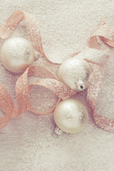 White Christmas ornaments with snow