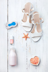Women's accessories. Sandals, cream, pumice stone, nail polish