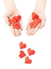 paper hearts in child hand