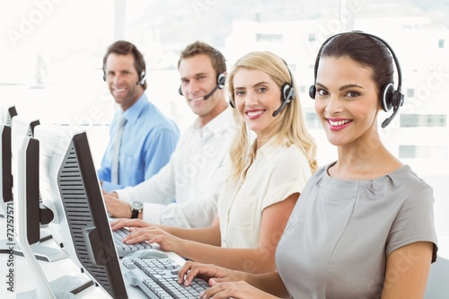 canvas print picture Business people with headsets using computers in office