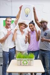 Creative business team holding Idea light bulb in meeting
