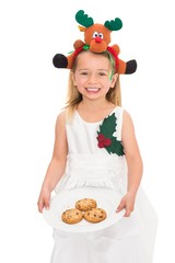 Festive little girl holding fresh cookies