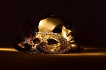 Two golden Venetian masks