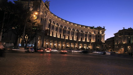 Traffic at night in Piazza della Repubblica, Rome, Italy