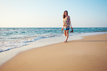 handsome woman walking on the beach