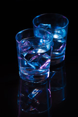 Two glasses of vodka with ice cubes