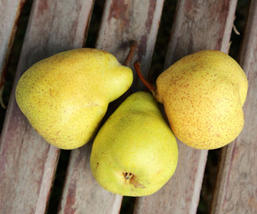 Three pears on the wooden surface