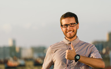 Positive professional man doing thumbs up gesture