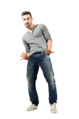 Trendy man posing with thumbs in pockets