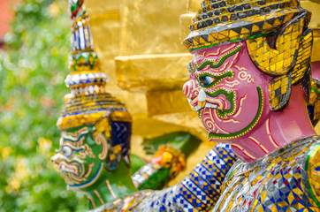 The demon statue supporting golden pagoda in Wat Phra Kaew