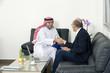 Senior Businessman Shaking hands with Arabian Businessman