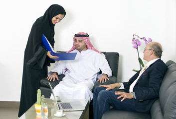 Arabian business people meeting with Foreigners in office