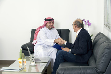Senior Businessman Shaking hands with Arabian Businessman