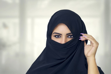 Beautiful Muslim girl wearing burqa closeup