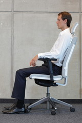 business man on chair in correct sitting position - resting
