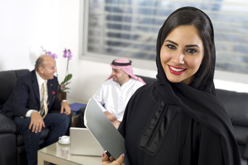 Arabian Businesswoman wearing Hijab against colleagues meeting