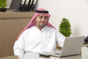 Arabian Businessman working on laptop in office