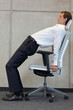 canvas print picture - yoga with chair in office - business man exercising