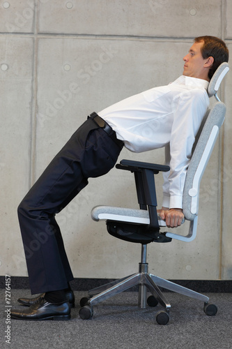 canvas print picture yoga with chair in office - business man exercising