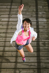 Sporty young happy woman jumping
