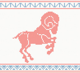 Red knitted pattern with sheep or goat