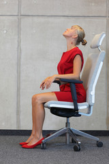 sitting woman in red dress relaxing neck looking up