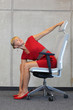 canvas print picture - yoga on chair in office - business woman exercising
