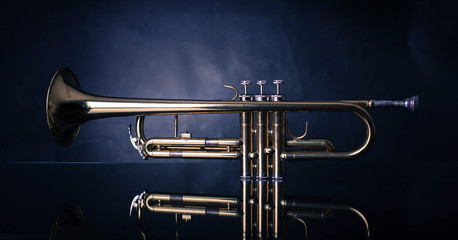 Shiny trumpet on wrinkled background