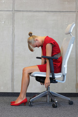 relax on chair in office - business woman exercising