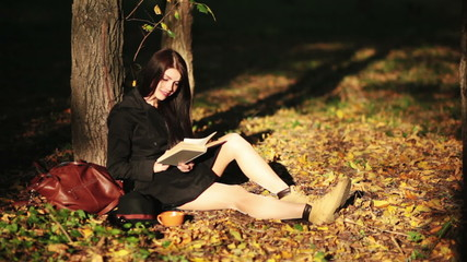 Young girl read book in park