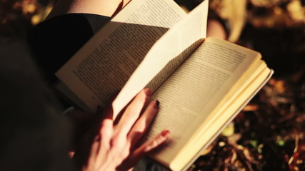 hands to turn the pages of the book