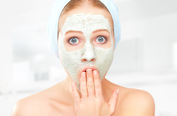 funny young woman and facial skin care mask