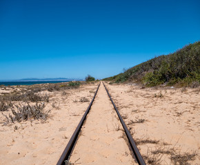 Steel Railroad Tracks on Sand Beach