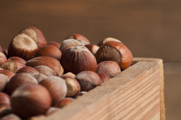 Hazelnut in wooden box.