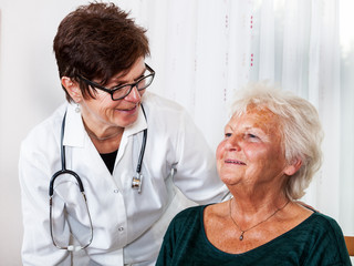 Doctor talking with elderly woman
