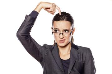 thoughtful beautiful business woman scratching her head