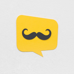 Yellow text bubble with mustaches