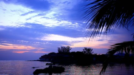 Buddha statue over scenic sunset sky background and sea on Koh