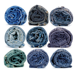 Collection of rolled jeans isolated on white background