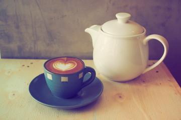 coffee latte on wooden desk vintage color